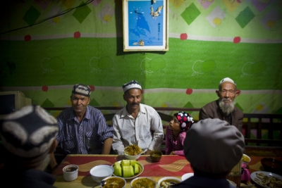 Shiho Fukada for The New York TimesUighurs in Hotan, a city in the Xinjiang region, gathering for dinner at the break of a Ramadan fast in 2010.
