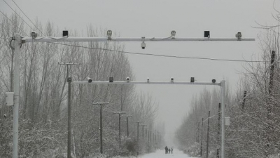 Big brother: Surveillance cameras keep watch on the roads entering Pilal village in Xinjiang. Photo: Sanghee Liu