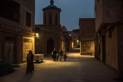Walking past a mosque in Kashgar, a city in China's western region of Xinjiang. More than 10 million Uighurs, a mostly Muslim minority group, live in the region. Credit Gilles Sabrie for The New York Times