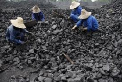 Chinese miners process coal from a mine in Huaibei, east China's Anhui province on July 13, 2010 (AFP/File)