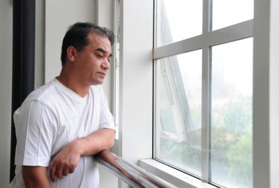 Ilham Tohti pauses before a classroom lecture in Beijing, June 12, 2010.  Photo: AFP