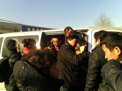 A dozen petitioners facing repatriation exit a van outside a government complex in Beijing, Dec. 9, 2013. Photo courtesy of petitioners