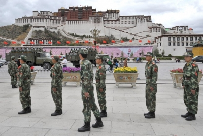 Chinese paramilitary police patrol in front of the Potala Palace in Lhasa, June 20, 2008.
