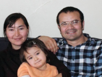 Abduweli Ayup (R) with his wife and daughter while studying in the U.S. in 2010. Photo courtesy of the family via RFA