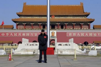 A security guard keeps watch at Tiananmen Square in Beijing, December 10, 2015.