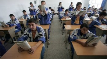 Uyghur students study at a bilingual middle school in Hotan, Xinjiang, in a file photo.