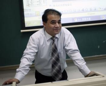 Professor Ilham Tohti lecturing in a classroom at Minzu University of China, Beijing