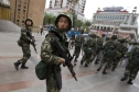 Chinese soldiers patrolling the streets of Urumqi, the capital of the Xinjiang Uighur Autonomous Region, in July 2009, after a protest over a fatal shooting of two Uighurs in southern China escalated into riots that killed at least 197 people. Credit Diego Azubel/European Pressphoto Agency